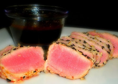 SESAME CRUSTED AHI TUNA STEAKS over greens (Adapted from Becoming Domestic)